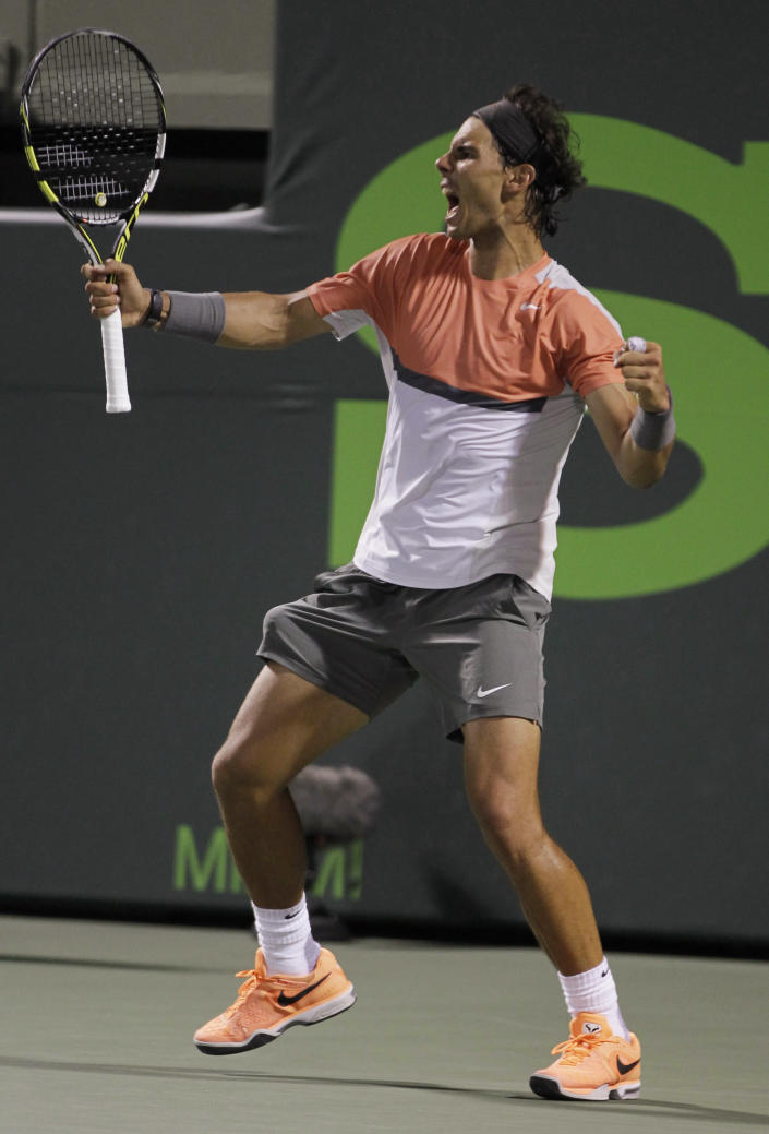 Rafael Nadal, of Spain, celebrates after defeating Milos Raonic, of Canada, 4-6, 6-2, 6-4 during the Sony Open tennis tournament, Thursday, March 27, 2014, in Key Biscayne, Fla. (AP Photo/Luis M. Alvarez)