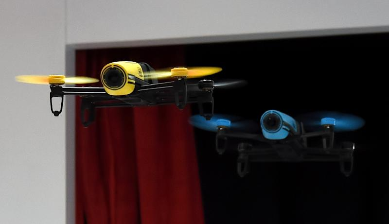 Drones fly at the 2015 International Consumer Eletronics Show at the Las Vegas Convention Center on January 8, 2015 (AFP Photo/Ethan Miller)