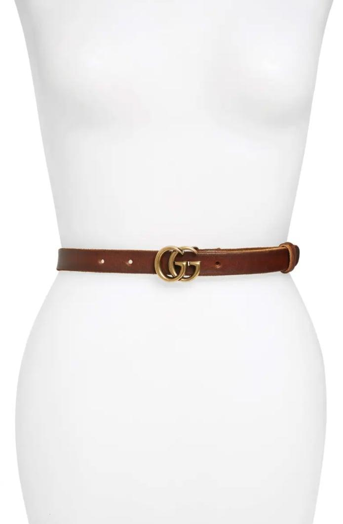 <p>They'll always want to accessorize if they have this <span>Gucci GG Leather Belt</span> ($360). We love the back detail on it. </p>