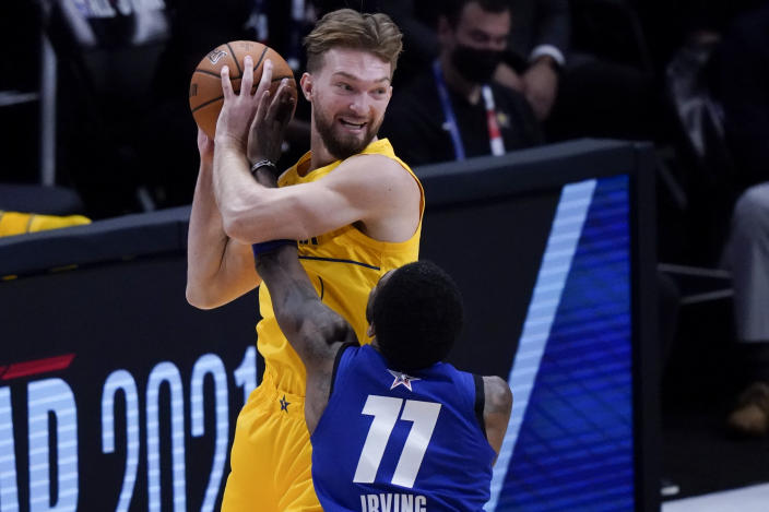 Brooklyn Nets guard Kyrie Irving guards Indiana Pacers forward Domantas Sabonis during the first half of basketball's NBA All-Star Game in Atlanta, Sunday, March 7, 2021. (AP Photo/Brynn Anderson)