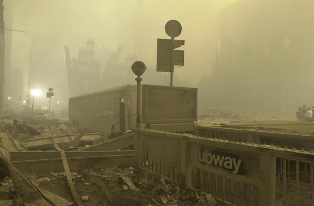 <p>A destroyed subway station near Ground Zero on the evening of Sept. 12, 2001. (Photo: Mark Lennihan/AP) </p>