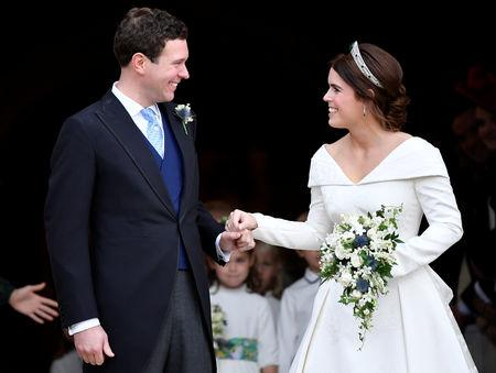Britain's Princess Eugenie and Jack Brooksbank leave the St George's Chapel after their wedding at Windsor Castle, Windsor, Britain October 12, 2018. REUTERS/Toby Melville