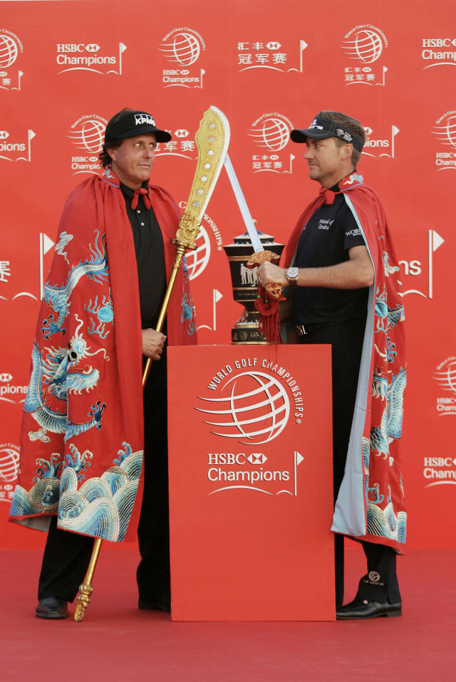 Ian Poulter of England, right, and Phil Mickelson of the United States, left, pose for photographers during a photo call at the HSBC Champions golf tournament Tuesday, Oct. 29, 2013 in Shanghai, China. The golf tournament will be held at Shanghai Sheshan International Golf Club from Oct. 31 to Nov. 3. (AP Photo)