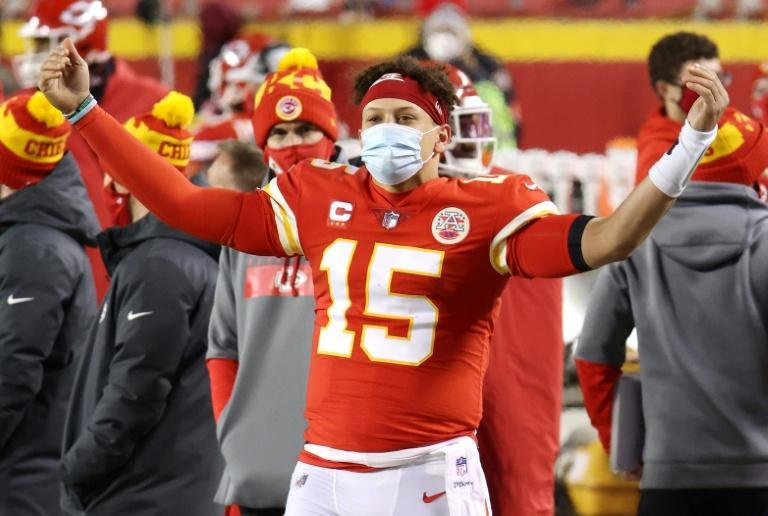 Patrick Mahomes celebrates on the sideline as the Kansas City Chiefs cruise to victory over the Buffalo Bills