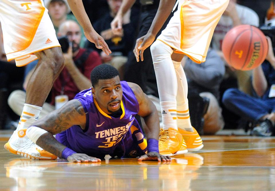 Tennessee Tech center Dwan Caldwell (32) loses the ball after being double-teamed by Tennessee guard Derek Reese, left, and forward Tariq Owens during the first half of an NCAA college basketball game in Knoxville, Tenn. on Friday, Dec. 19, 2014. (AP Photo/Knoxville News Sentinel, Adam Lau)