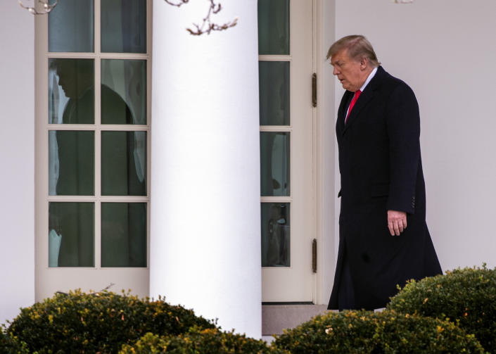 President  Donald Trump walks to the Oval Office after he and First Lady Melania Trump arrive on the South Lawn of the White House after returning from Florida, in Washington, DC on December 31.  (Bill O'Leary/The Washington Post via Getty Images)