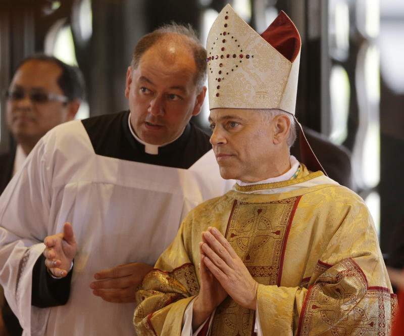 Salvatore J. Cordileone, right, waits to be introduced during a ceremony to install him as the new archbishop of San Francisco at the Cathedral of St. Mary of the Assumption in San Francisco, Thursday,  Oct. 4, 2012. (AP Photo/Marcio Jose Sanchez, Pool)