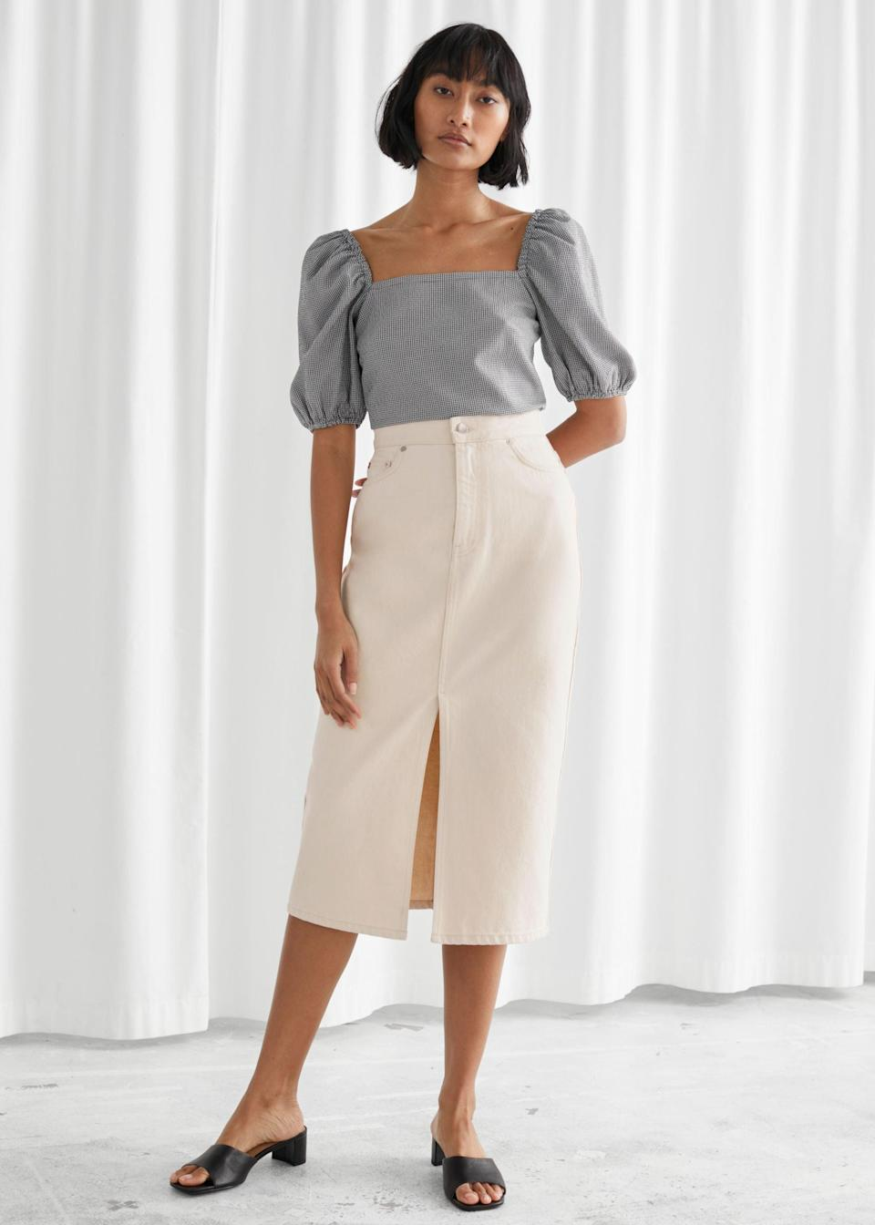 """<br> <br> <strong>& Other Stories</strong> Denim Front Slit Midi Skirt, $, available at <a href=""""https://go.skimresources.com/?id=30283X879131&url=https%3A%2F%2Fwww.stories.com%2Fen_usd%2Fclothing%2Fskirts%2Fdenim-skirts%2Fproduct.denim-front-slit-midi-skirt-white.0864546001.html"""" rel=""""nofollow noopener"""" target=""""_blank"""" data-ylk=""""slk:& Other Stories"""" class=""""link rapid-noclick-resp"""">& Other Stories</a>"""
