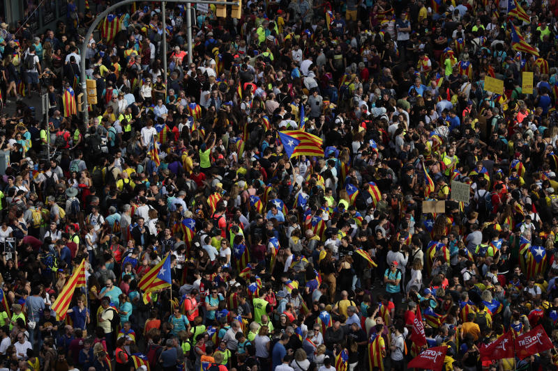 """Protesters pack the street on the fifth day of protests over the conviction of a dozen Catalan independence leaders in Barcelona, Spain, Friday, Oct. 18, 2019. Tens of thousands of flag-waving demonstrators demanding Catalonia's independence and the release from prison of their separatist leaders have flooded downtown Barcelona. The protesters have poured into the city after some of them walked for three days in """"Freedom marches"""" from towns across the northeastern Spanish region, joining students and workers who have also taken to the streets on a general strike day. (AP Photo/Manu Fernandez)"""