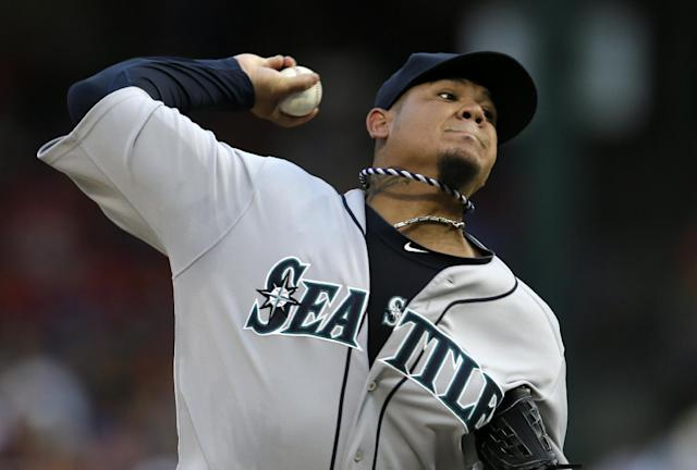 Seattle Mariners starting pitcher Felix Hernandez (34) works against the Texas Rangers in the first inning of a baseball game, Saturday, Aug. 17, 2013, in Arlington, Texas. (AP Photo/Tony Gutierrez)