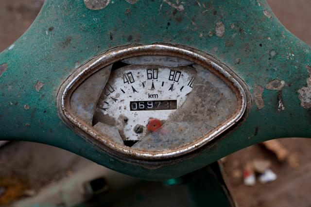 <p>A broken speed meter is seen on an abandoned Vespa scooter, in a street corner in Karachi, Pakistan, March 6, 2018. (Photo: Akhtar Soomro/Reuters) </p>