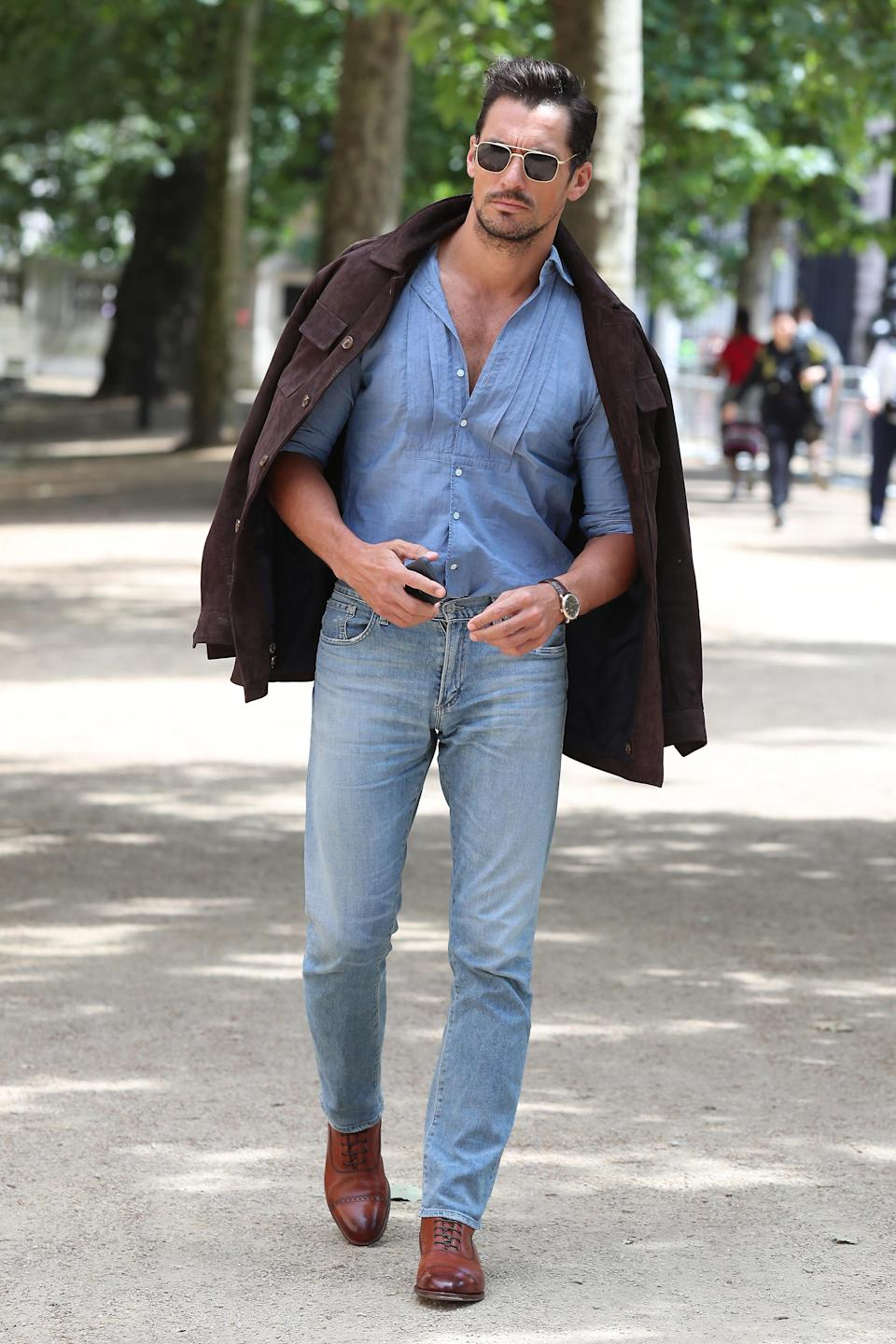 <p>The best dressed list isn't just reserved for women as proved by David Gandy who looks sauve in a pair of blue jeans, a blue shirt with brown shoes and a coat thrown over this shoulders. <br><em>[Photo: Getty]</em> </p>