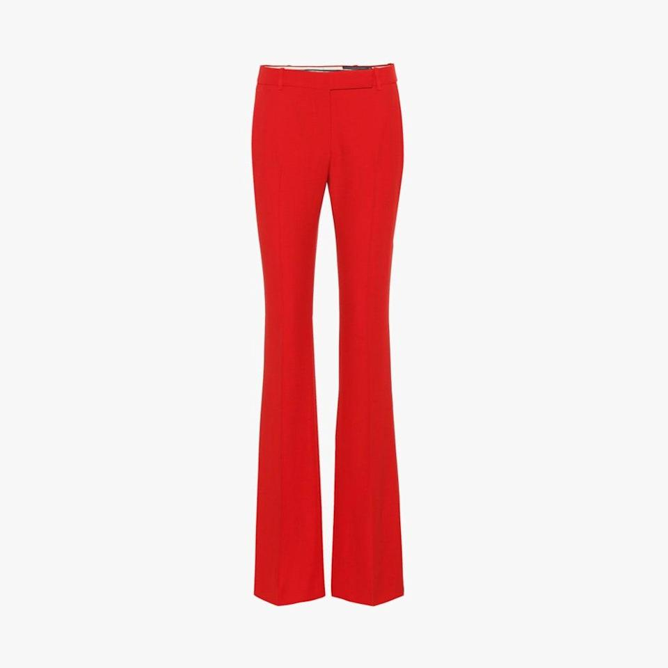 "$745, MYTHERESA. <a href=""https://www.mytheresa.com/en-us/alexander-mcqueen-mid-rise-flared-pants-1103373.html"" rel=""nofollow noopener"" target=""_blank"" data-ylk=""slk:Get it now!"" class=""link rapid-noclick-resp"">Get it now!</a>"