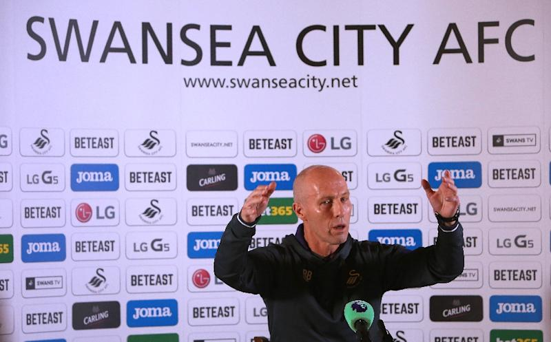 Premier League football club, Swansea City's new US manager Bob Bradley gestures as he hosts a press conference at the Marriot Hotel in Swansea, south wales on October 7, 2016 (AFP Photo/Geoff Caddick)