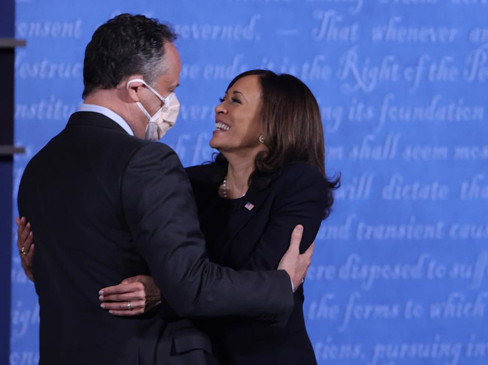 SALT LAKE CITY, UTAH - OCTOBER 07: Democratic vice presidential nominee Sen. Kamala Harris (D-CA) hugs husband Douglas Emhoff after in the vice presidential debate against U.S. Vice President Mike Pence at the University of Utah on October 7, 2020 in Salt Lake City, Utah. The vice presidential candidates only meet once to debate before the general election on November 3. (Photo by Alex Wong/Getty Images)