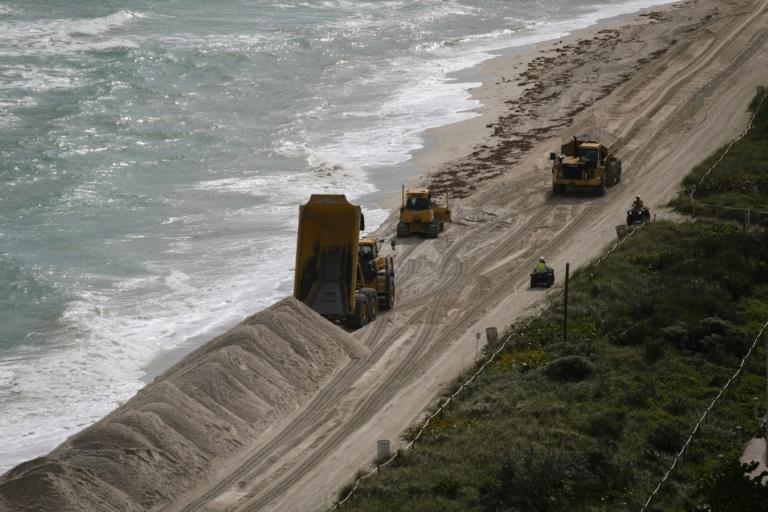 Heavy machinery dumping sand at Miami Beach shoreline in Miami Beach on January 17, 2020, opart of a plan to protect the beach from the effects of climate change and hurricanes (AFP Photo/Eva Marie UZCATEGUI)