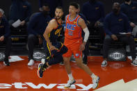 Golden State Warriors guard Stephen Curry (30) reacts as he misses a three-point attempt in front of Oklahoma City Thunder center Isaiah Roby (22) during the first half of an NBA basketball game in San Francisco, Thursday, May 6, 2021. (AP Photo/Jeff Chiu)
