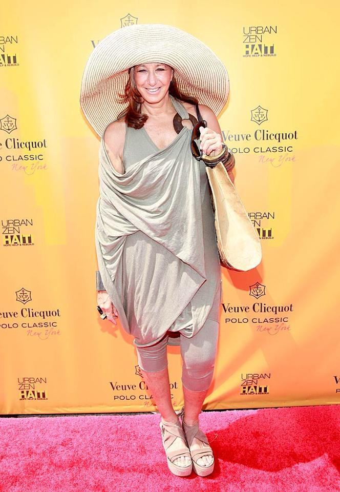 """What's the worst part of the unsightly ensemble fashion designer Donna Karan wore to the annual Veuve Clicquot Polo Classic? Her sand-colored smock, her mummy-esque platform sandals, or her absurdly large sunhat? Charles Eshelman/<a href=""""http://www.gettyimages.com/"""" target=""""new"""">GettyImages.com</a> - June 5, 2011"""