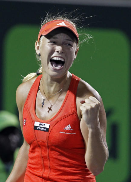 Caroline Wozniacki, of Denmark, celebrates her 6-4, 6-4 win against Serena Williams, of the United States, during the Sony Ericsson Open tennis tournament in Key Biscayne, Fla., Tuesday, March 27, 2012. (AP Photo/Alan Diaz)
