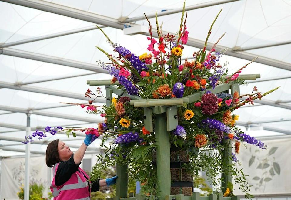 The final touches are completed on a giant display in the Co-op Communities in Bloom garden (Yui Mok/PA) (PA Wire)