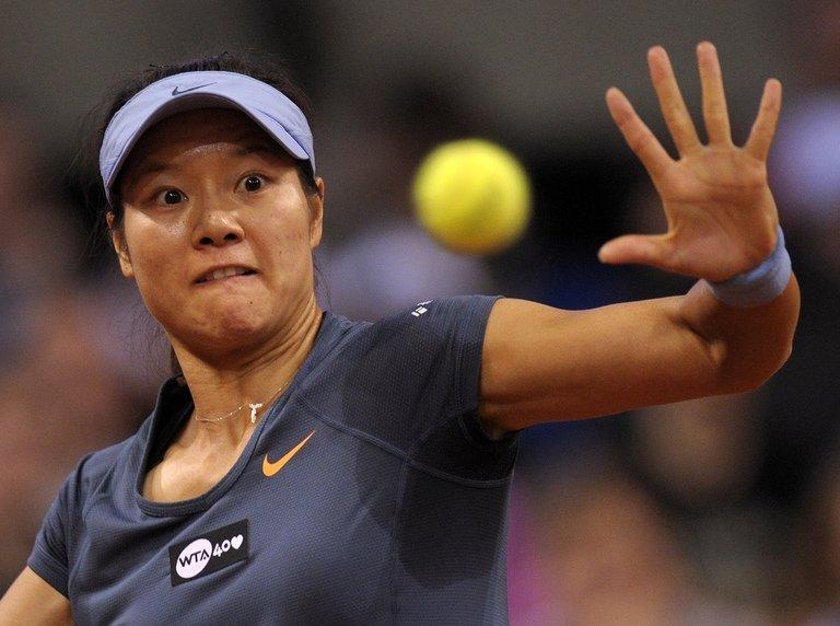 Li Na, seen in action during the final match versus Maria Sharapova at the WTA Porsche Tennis Grand Prix in Stuttgart, southwestern Germany, on April 28, 2013. Li's season to date has been somewhat of a roller-coaster