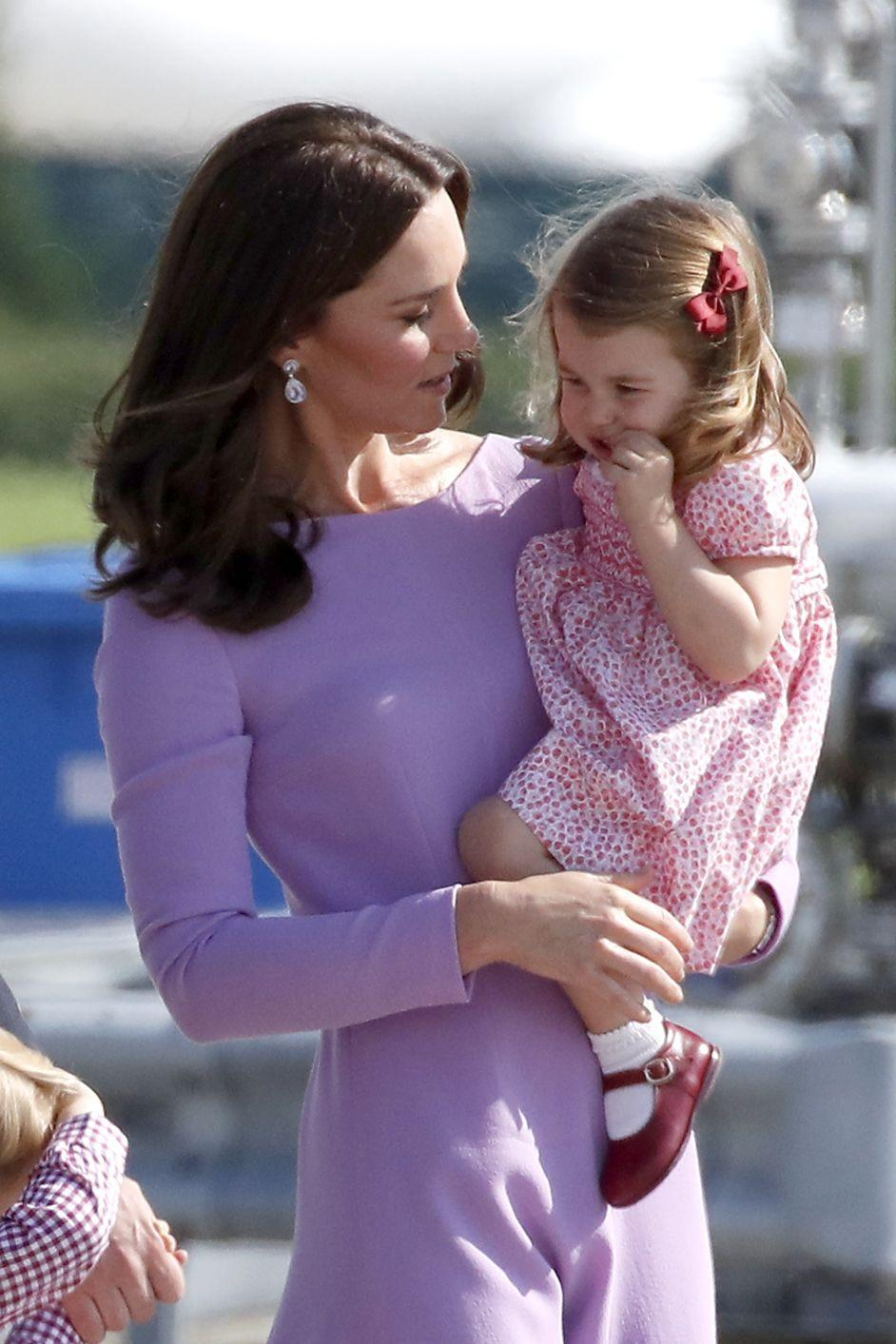 """<p>Princess Charlotte and her mom, Catherine, Duchess of Cambridge had a pastel mommy-and-me moment during the royals' official visit to Poland and Germany in July 2017. </p><p><strong>More:</strong> <a href=""""https://www.townandcountrymag.com/society/tradition/g9570478/princess-charlotte-photos-news/"""" rel=""""nofollow noopener"""" target=""""_blank"""" data-ylk=""""slk:The Sweetest Photos of Princess Charlotte"""" class=""""link rapid-noclick-resp"""">The Sweetest Photos of Princess Charlotte</a></p>"""