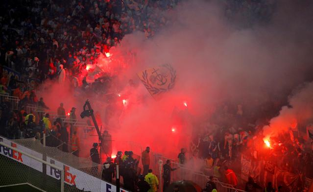 Soccer Football - Europa League Final - Olympique de Marseille vs Atletico Madrid - Groupama Stadium, Lyon, France - May 16, 2018 Marseille fans set off flares in the stand during the match REUTERS/Vincent Kessler