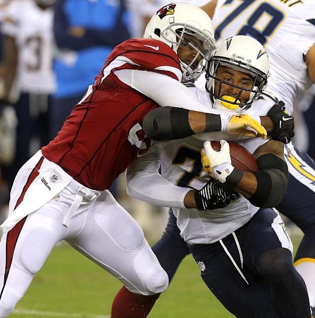 San Diego Chargers running back Ryan Mathews, right, is tackled by Arizona Cardinals defensive end John Abraham, left, during the first half of a preseason NFL football game, Saturday, Aug. 24, 2013, in Glendale, Ariz. (AP Photo/Rick Scuteri)