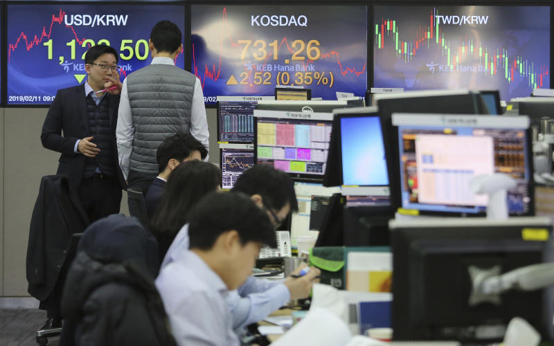 Currency traders work at the foreign exchange dealing room of the KEB Hana Bank headquarters in Seoul, South Korea, Monday, Feb. 11, 2019. Asian stocks were mixed on Monday as traders watched for developments on a fresh round of trade talks in Beijing this week. (AP Photo/Ahn Young-joon)