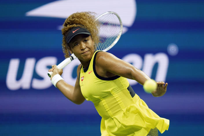 Naomi Osaka, of Japan, returns a shot to Marie Bouzkova, of the Czech Republic, during the first round of the US Open tennis championships, Monday, Aug. 30, 2021, in New York. (AP Photo/Elise Amendola)