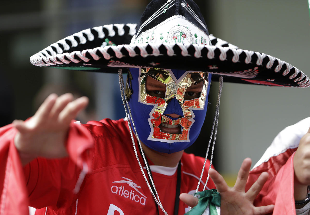 A Mexico fan cheers prior to the men's group B soccer match between Mexico and Gabon at the London 2012 Summer Olympics, in Coventry, England, Sunday, July 29, 2012. (AP Photo/Hussein Malla)
