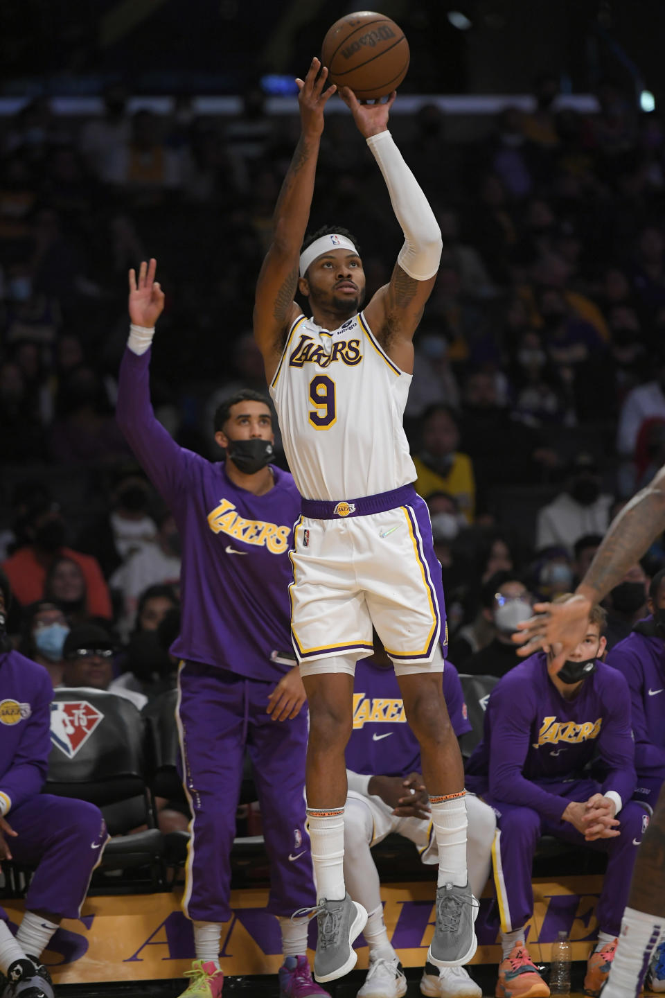 Los Angeles Lakers forward Kent Bazemore (9) takes a jumpshot against the Phoenix Suns in the second half of a preseason NBA basketball game in Los Angeles, Sunday, Oct. 10, 2021. (AP Photo/John McCoy)