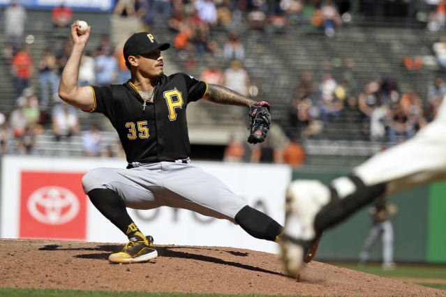 Pittsburgh Pirates relief pitcher Keone Kela throws out the San Francisco Giants' Buster Posey at first base in the seventh inning of a baseball game Thursday, Sept. 12, 2019, in San Francisco. (AP Photo/Eric Risberg)