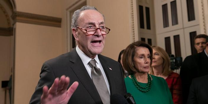 Senate Minority Leader Chuck Schumer and House Democratic Leader Nancy Pelosi of California, the speaker-designate for the new Congress, talk to reporters as Congress tries to avert a partial shutdown, in Washington, Thursday, Dec. 20, 2018.