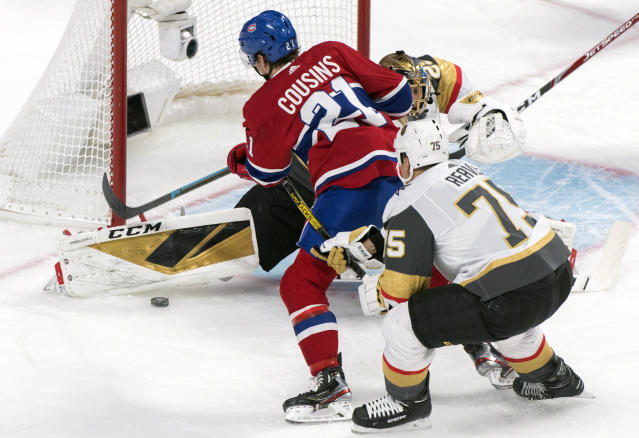 Montreal Canadiens' Nick Cousins (21) scores against Vegas Golden Knights goaltender Marc-Andre Fleury as Knights' Ryan Reaves defends during first-period NHL hockey game action in Montreal, Saturday, Jan. 18, 2020. (Graham Hughes/The Canadian Press via AP)