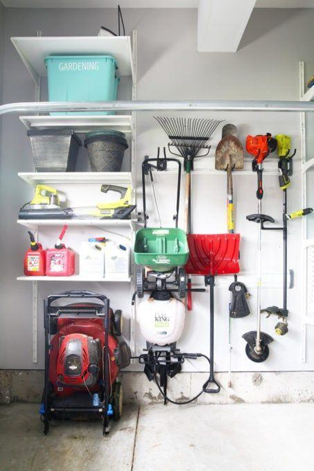 """<p>One of the best ways to organize your garage is by grouping gear of the same kind together so it's easy to find. Using a combination of shelves and hooks, this gardening equipment is stored neatly side-by-side, with a large, labeled bin for holding smaller items.</p><p><strong>Get the tutorial at <a href=""""https://justagirlandherblog.com/planning-a-garage-organization-project/"""" rel=""""nofollow noopener"""" target=""""_blank"""" data-ylk=""""slk:Just a Girl and Her Blog"""" class=""""link rapid-noclick-resp"""">Just a Girl and Her Blog</a>.</strong></p><p><a class=""""link rapid-noclick-resp"""" href=""""https://www.amazon.com/Zilpoo-Storage-Organizer-Stackable-Containers/dp/B07ST55LRJ/ref=sr_1_3?tag=syn-yahoo-20&ascsubtag=%5Bartid%7C10050.g.36449426%5Bsrc%7Cyahoo-us"""" rel=""""nofollow noopener"""" target=""""_blank"""" data-ylk=""""slk:SHOP PLASTIC BINS"""">SHOP PLASTIC BINS</a></p><p><strong>RELATED:</strong> <strong><a href=""""https://www.countryliving.com/gardening/garden-ideas/g4367/best-gardening-tools/"""" rel=""""nofollow noopener"""" target=""""_blank"""" data-ylk=""""slk:Must-Have Gardening Tools to Keep Your Lawn and Flower Beds Charming"""" class=""""link rapid-noclick-resp"""">Must-Have Gardening Tools to Keep Your Lawn and Flower Beds Charming</a></strong></p>"""