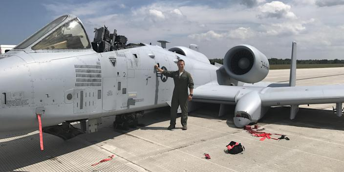 Then-Capt. Brett DeVries, an A-10 Thunderbolt II pilot of the 107th Fighter Squadron from Selfridge Air National Guard Base, next to the aircraft he safely landed after a malfunction forced him to make an emergency landing July 20, 2017