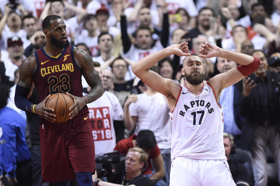 Jonas Valanciunas (right) reacts after missing a shot late in the fourth quarter, giving LeBron James and the Cavs a chance to come back from an early deficit. (Nathan Denette/The Canadian Press via AP)