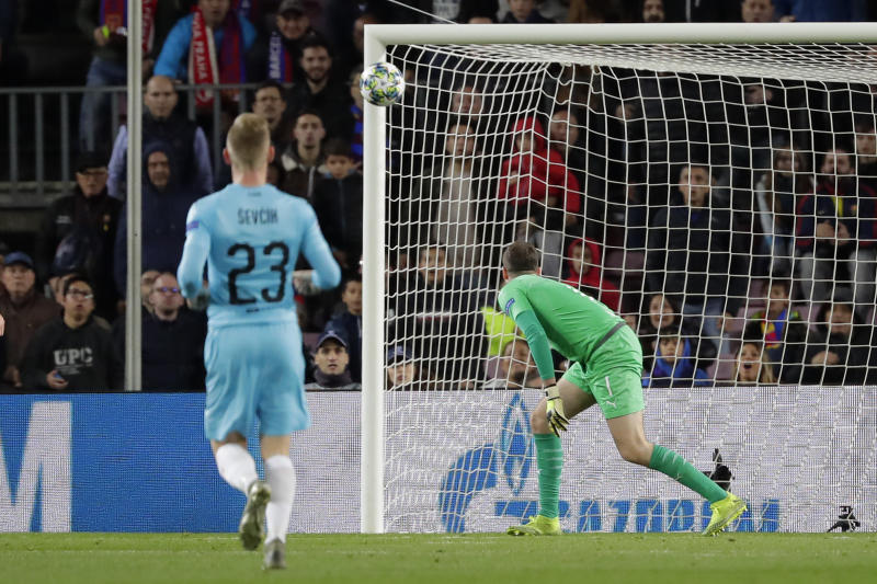 Slavia's goalkeeper Ondrej Kolar watches Barcelona's Lionel Messi's shot bounce off the post during a Champions League group F soccer match between Barcelona and Slavia Praha at Camp Nou stadium in Barcelona, Spain, Tuesday, Nov. 5, 2019. (AP Photo/Emilio Morenatti)