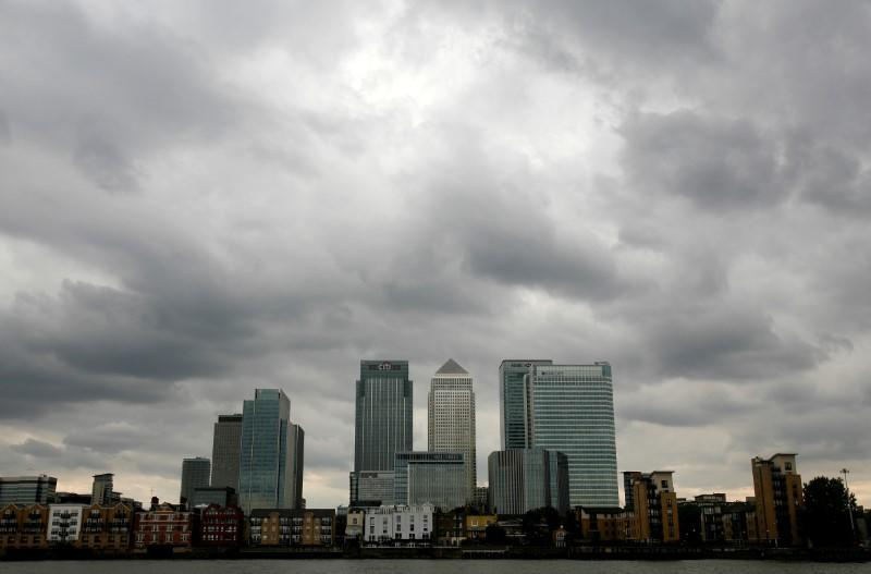 Storm clouds are seen above Canary Wharf financial district in London