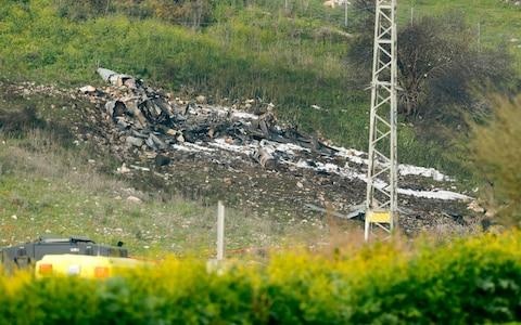The remains of the Israel F-16 jet in the northern Israeli Kibbutz of Harduf - Credit:  JACK GUEZ