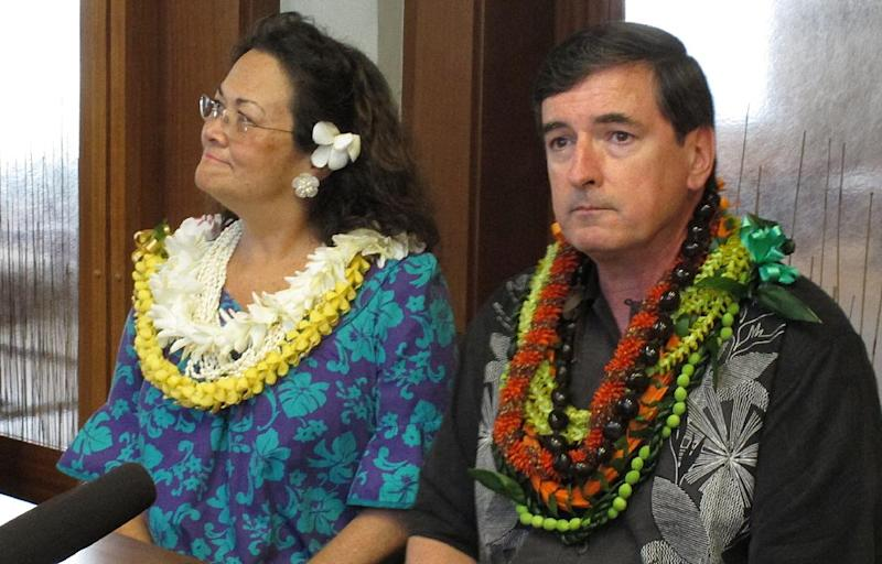 Anchorage, Alaska Mayor Dan Sullivan, right, and wife Lynnette take questions from reporters after he takes the oath of office through video conferencing in Honolulu on Monday, July 2, 2012. Sullivan had a previously scheduled family vacation to Hawaii, where his wife grew up. (AP Photo/Oskar Garcia)
