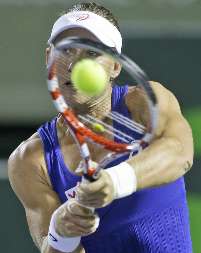 Samantha Stosur, of Australia, returns a shot from Coco Vandeweghe, of the United States, at the Sony Open tennis tournament, early Sunday, March 23, 2014, in Key Biscayne, Fla. (AP Photo/Wilfredo Lee)