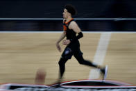 Oklahoma State's Cade Cunningham runs with the ball during the second half of an NCAA college basketball against Baylor game in the semifinals of the Big 12 tournament in Kansas City, Mo., Friday, March 12, 2021. (AP Photo/Charlie Riedel)