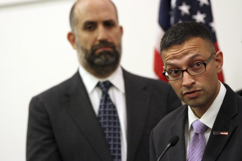 Syed Farhaj Hassan, right, is joined by Glenn Katon, legal director of Muslim Advocates, as he speaks to reporters during a news conference, Wednesday, June 6, 2012 in New York. Hassan is one of eight Muslims who filed a federal lawsuit Wednesday in New Jersey to force the New York Police Department to end its surveillance and other intelligence-gathering practices targeting Muslims in the years after the 2001 terrorist attacks. The lawsuit alleged that the police activities were unconstitutional because they focused on people's religion, national origin and race. (AP Photo/Mary Altaffer)