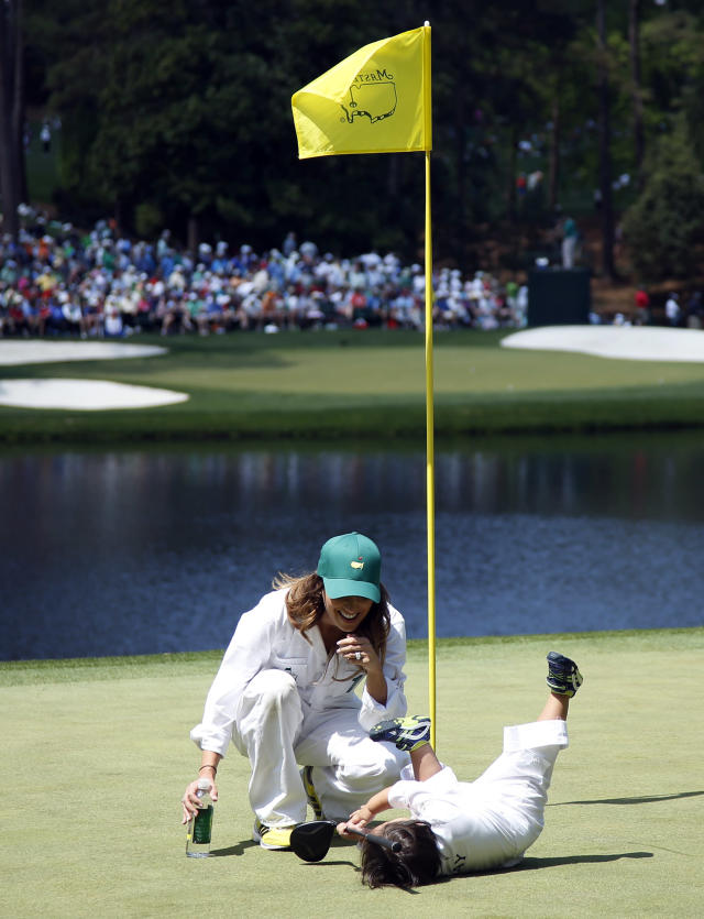 Australia's Jason Day's wife Ellie tries to console their son Dash after he wanted to play with another golf ball during the par three competition at the Masters golf tournament Wednesday, April 9, 2014, in Augusta, Ga. (AP Photo/Matt Slocum)