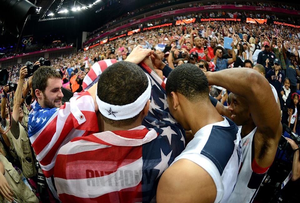 LONDON, ENGLAND - AUGUST 12: The United States players celebrate winning the Men's Basketball gold medal game between the United States and Spain on Day 16 of the London 2012 Olympics Games at North Greenwich Arena on August 12, 2012 in London, England. (Photo by Harry How/Getty Images)