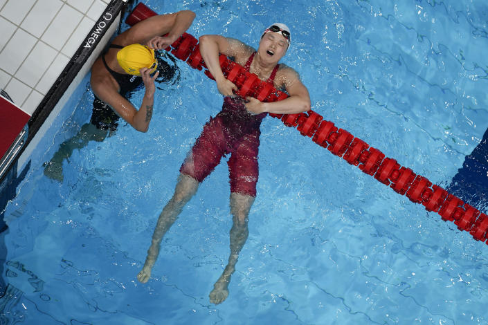Margaret MacNeil, of Canada, right, reacts after winning the final of the women's 100-meter butterfly as Sarah Sjoestroem, of Sweden, looks on at the 2020 Summer Olympics, Monday, July 26, 2021, in Tokyo, Japan. (AP Photo/Morry Gash)