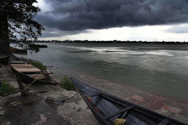 Fishery boats are parked as clouds cover the skies over the river Ganges ahead of Cyclone Amphan on May 19, 2020 in Kolkata. (Photo by Debajyoti Chakraborty/NurPhoto via Getty Images)