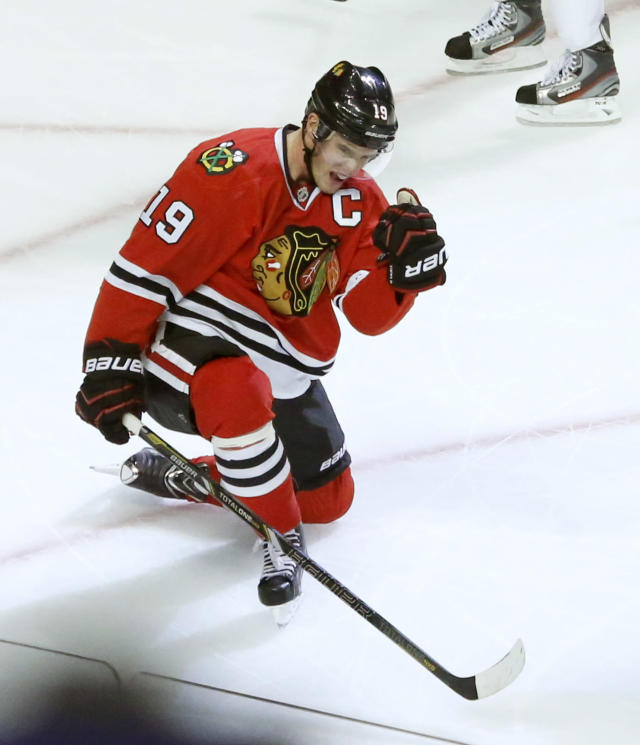 Chicago Blackhawks center Jonathan Toews celebrates his third goal of the night, during the third period of an NHL hockey game against the Ottawa Senators on Tuesday, Oct. 29, 2013, in Chicago. The Blackhawks won 6-5. (AP Photo/Charles Rex Arbogast)
